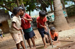 children at water point, philippines